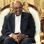 Sudan's President Omar al-Bashir smiles during an interview with the Russia Today news channel at the Presidential Palace in Khartoum