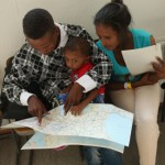 ROSENHEIM, GERMANY - AUGUST 31:  A young migrant couple from Eritrea look on a map of Europe as they prepare to depart with their son after they completed the registration process at a center for migrants at a facility of the German Federal Police (Bundespolizei) on August 31, 2015 in Rosenheim, Germany. German police monitor trains arriving from the Balkans and from Italy that go through Rosenheim and currently detain around 350 people a day for travelling without a passport. The police register the migrants, mostly from countries including Syria, Afghanistan and Eritrea, fingerprint them and check whether any are already in the European asylum-applicants or criminal databases. From there the migrants are free to travel within Germany to reception centers where they can apply for asylum. Up to 1,600 migrants are currently arriving in Bavaria in southern Germany a day and will seek asylum. Germany is expecting to receive 800,000 asylum-seeking migrants this year and is struggling to cope with the record number.  (Photo by Sean Gallup/Getty Images)