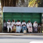Passangers wait for public transport at a bus-stop in Eritrea's capital Asmara, February 20, 2016. REUTERS/Thomas Mukoya